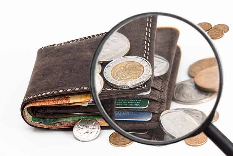 Photo of a wallet with coins