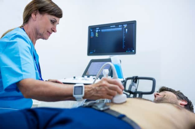 man getting ultrasound abdomen from doctor