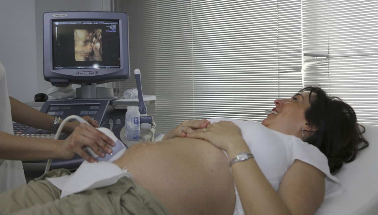 Ultrasound technician checking patient